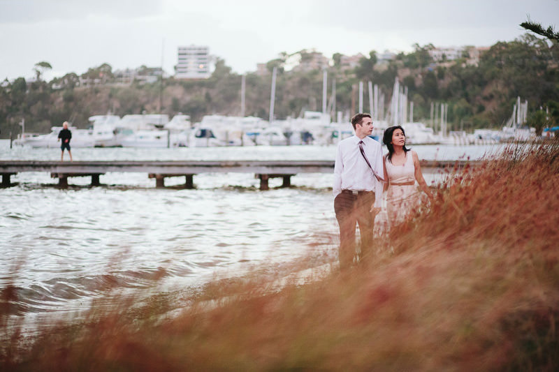 engagement photo of couple walking down beach in claremont