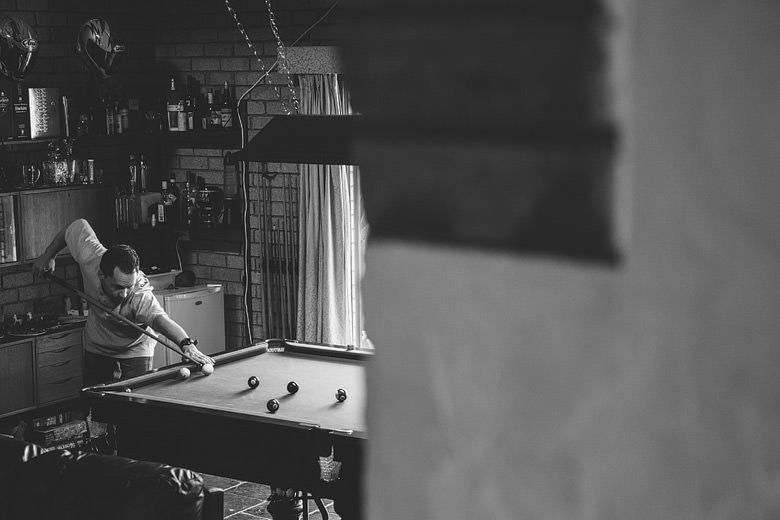 Groom plays pool, snooker, creative photgraphy