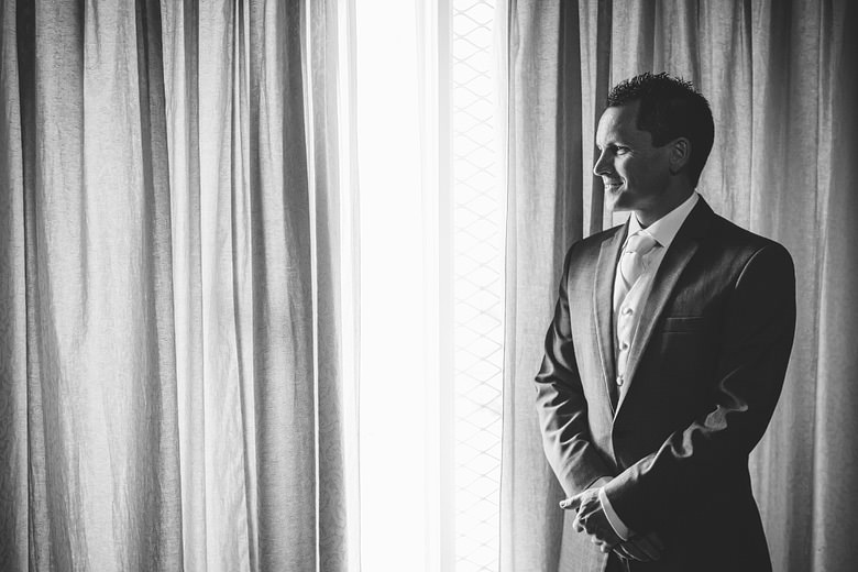Wedding, stunning groom portrait, window light