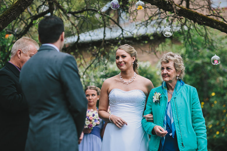 Wedding ceremony photo, elegant bride, mum, giveaway
