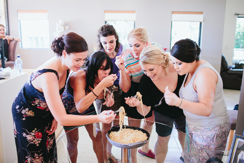 bridesmaids eating spaghetti