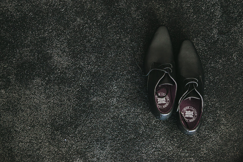 detail of groom's shoes
