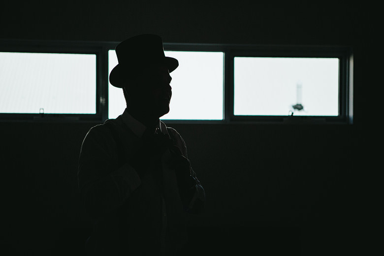 silhouette of groom in top hat