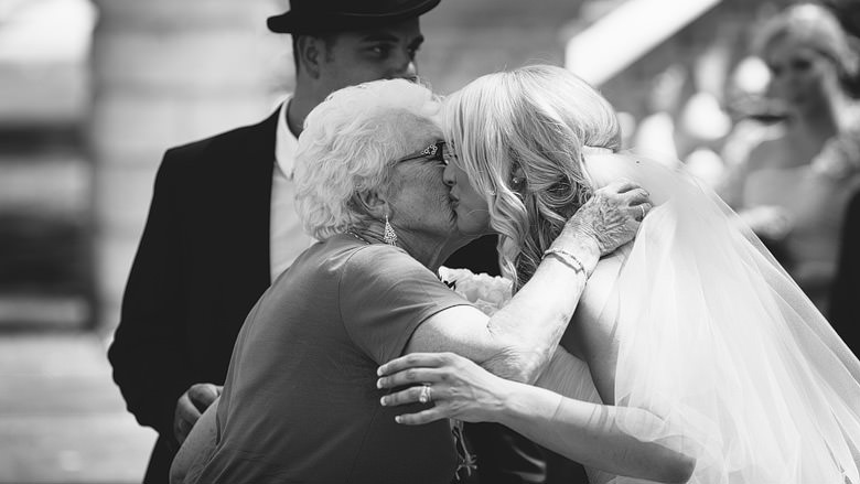 bride is congratulated by grandmother