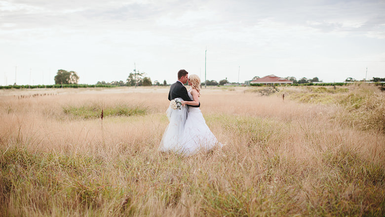 bride and groom portrait in long grass