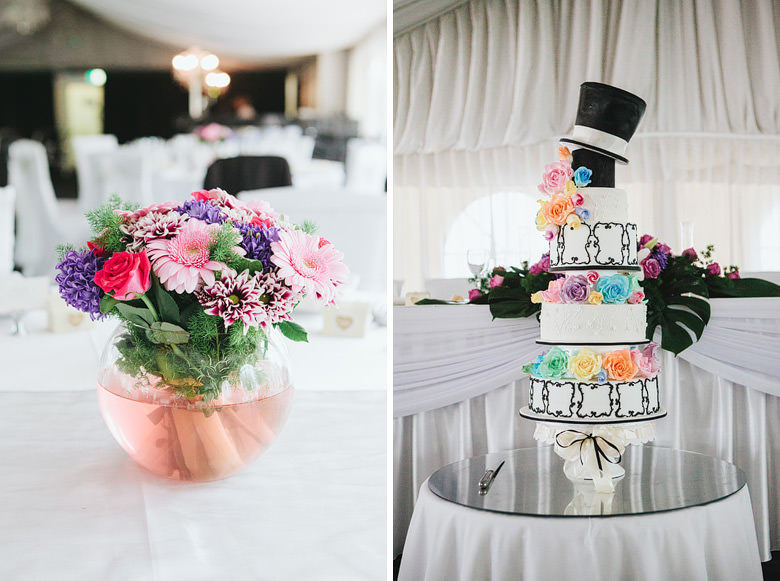 detail of wedding cake and floral centrepieces