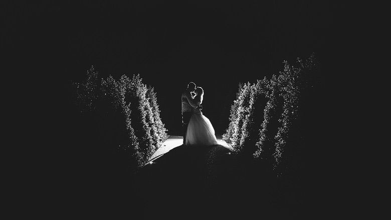 bride and groom silhouette kiss shot during wedding
