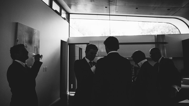 groomsmen artistic wedding photography black and white aqua resort