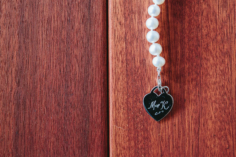 engraved charm on pearl bracelet