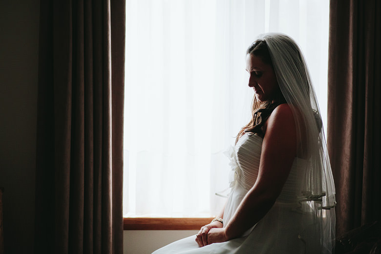 bridal portrait backlighting in front of window