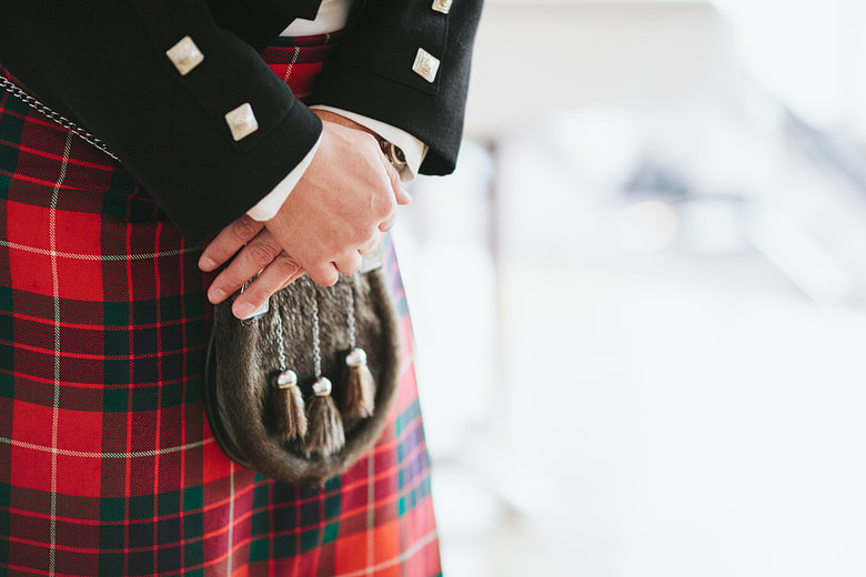 detail image of groom's hands and kilt as he waits for the bride