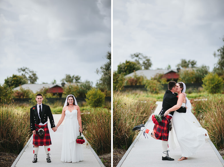 bride and groom kissing during location shoot kilt