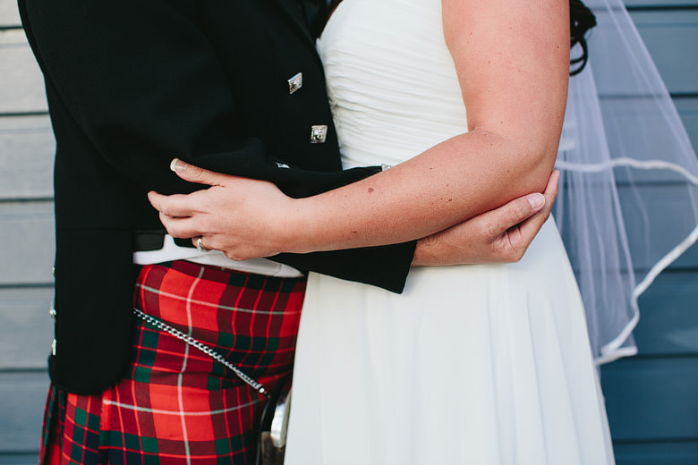 intimate photo of bride and groom in each others arms