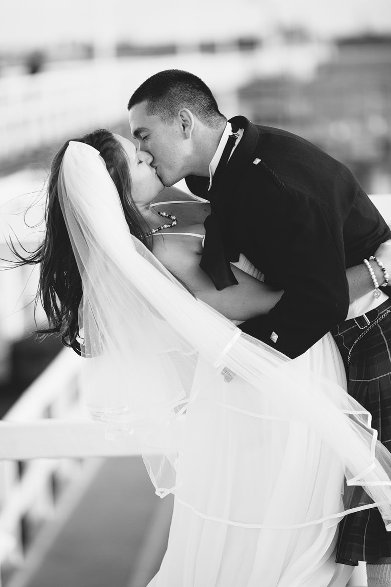 romantic windswept kiss during location shoot on wedding day