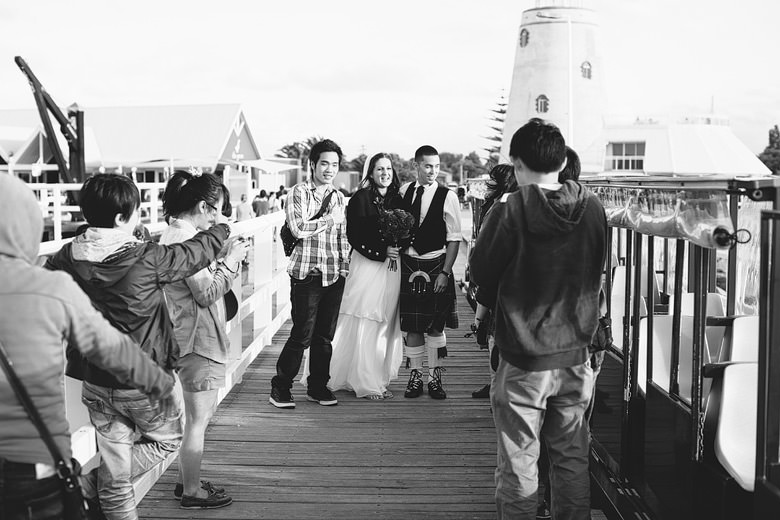 photojournalistic style image of bride and groom at busselton jetty during wedding