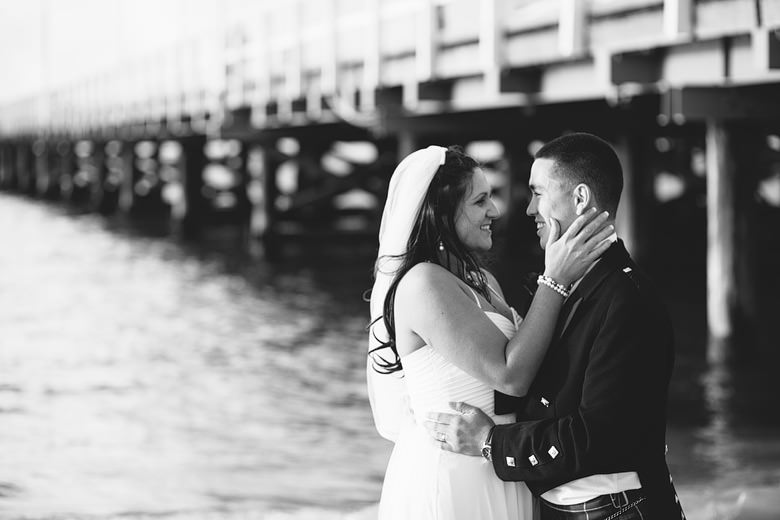 romantic image of couple in front of the busselton jetty