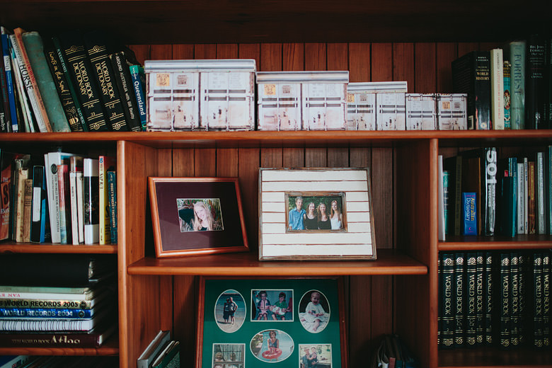 bookshelf with family portraits