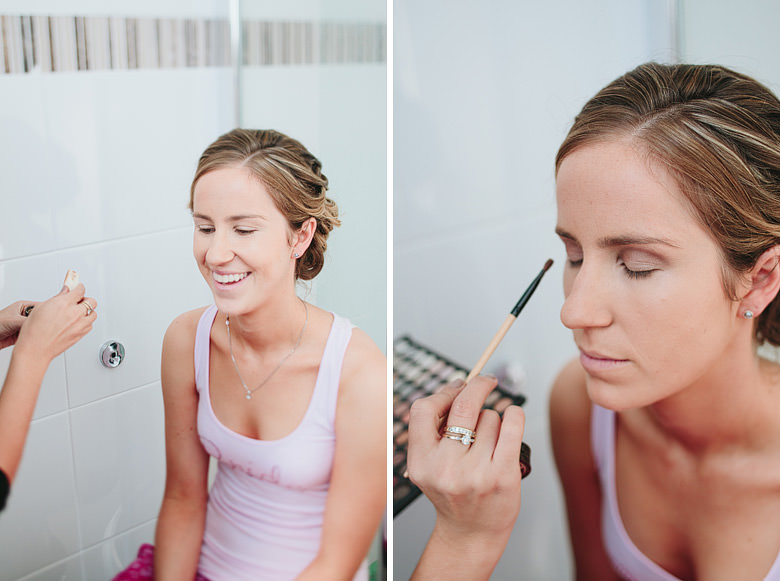 make up artist applying make up on bride