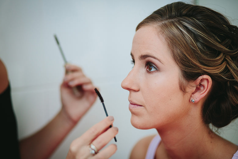 bride having mascara applied