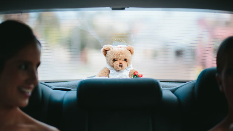 bride teddy bear in back of limousine