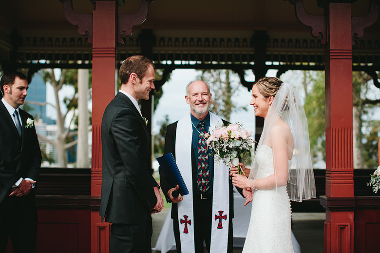 bride and groom smiling at ceremony with celebrant