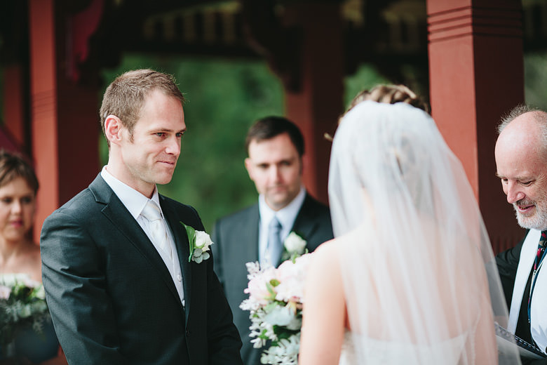 Candid groom looking at bride