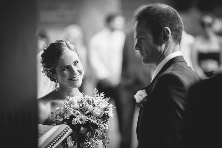 candid bride smiling at groom