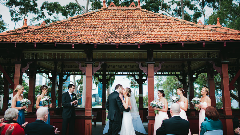 Bride and groom first kiss old tea pavilion Kings Park