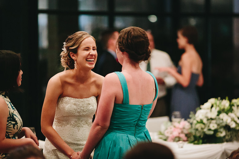 candid bride joking with guest