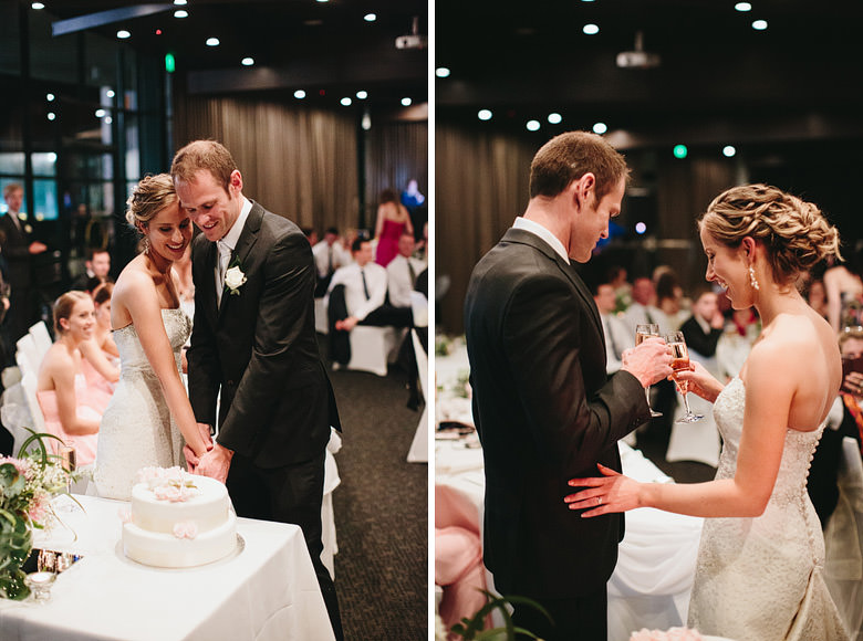 couple cutting wedding cake and champagne cheers