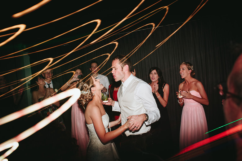 bride and groom dancing silly fun photo