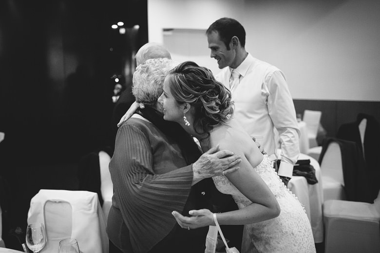 grandmother hugging bride goodbye